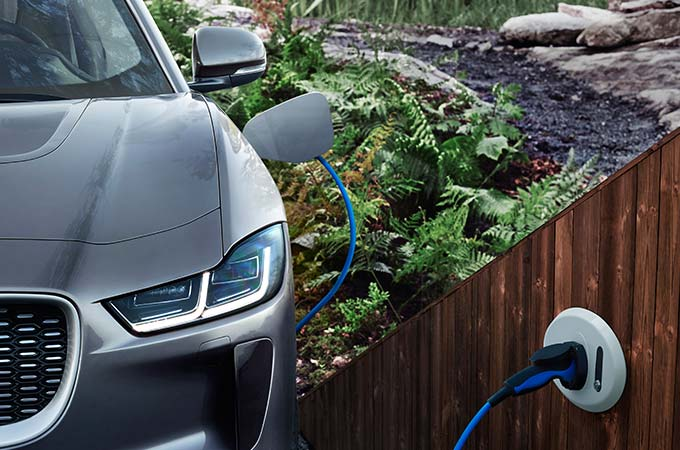 A Grey Jaguar I-Pace Being Charged Using a Home Charger