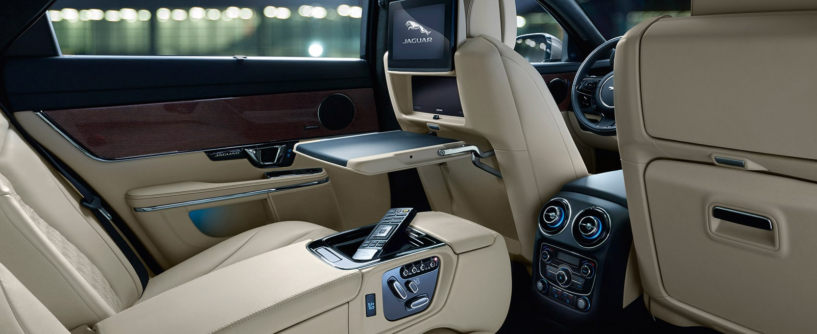 Rear Seats of Jaguar XJ with Tray Table and Arm Rest in Position